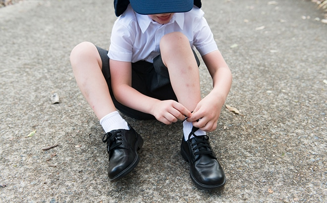 tying shoe laces on school shoes